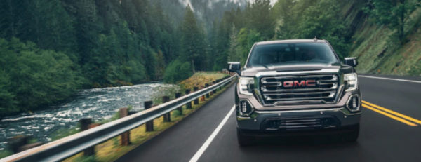 The 2019 GMC Sierra 1500 driving down the street.