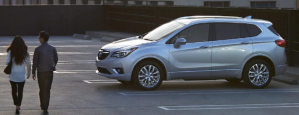 Silver 2019 Buick Envision parked on top level of parking deck