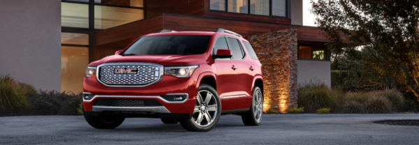 Red 2019 GMC Acadia Denali parked in residential driveway